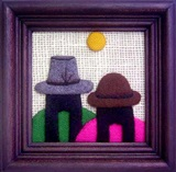 Artisan wall hanging with two cholitas