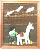 Artisan wall hanging with young boy