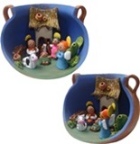 Andean nativity scene inside a ceramic pot
